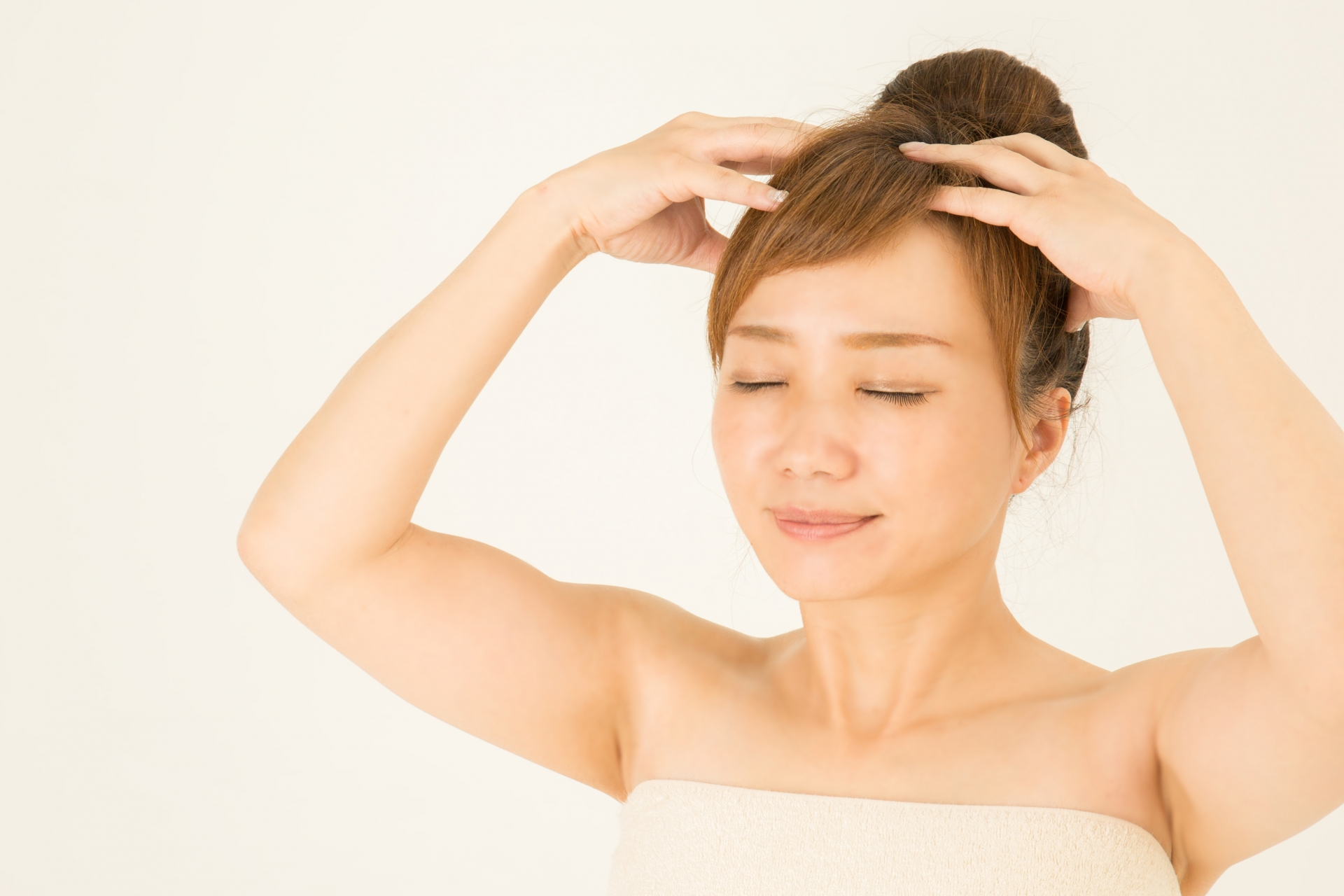 肩こりの痛みを和らげる頭皮マッサージとは